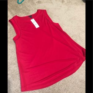 And Taylor New....Red sleeveless blouse